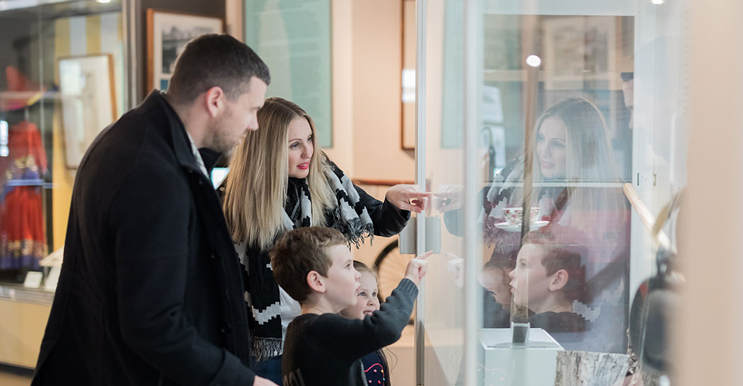 Family browsing exhibitions at the Museum of the Riverina Botanic Gardens site in Wagga Wagga